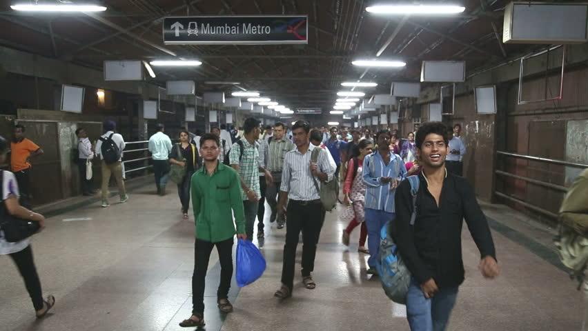 MUMBAI, INDIA - 8 JANUARY 2015: Crowd passing through the train station of Mumbai. - HD stock video clip