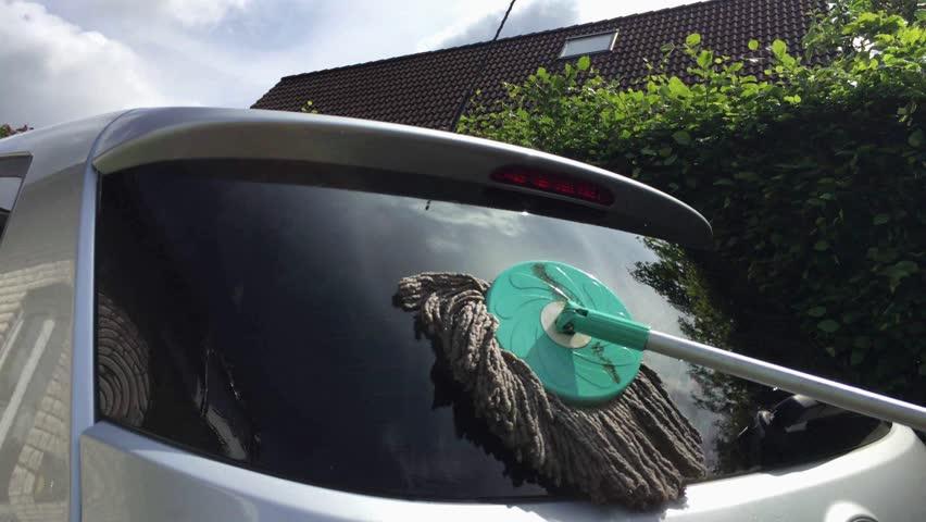 Cleaning the rear window in the car. | Shutterstock HD Video #11528507