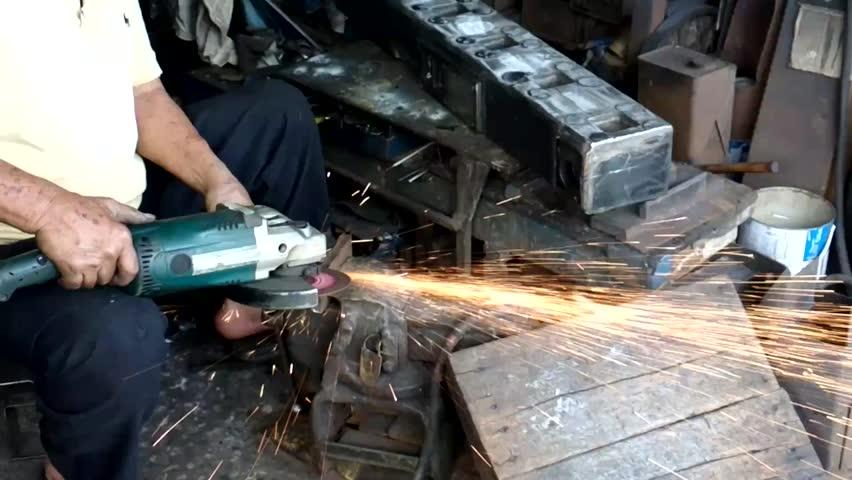 Industrial worker grinding metal  - HD stock video clip