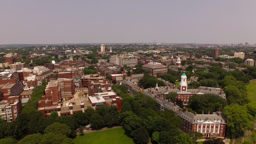 Boston Aerial v100 Flying low over Harvard campus panning right with cityscape views.