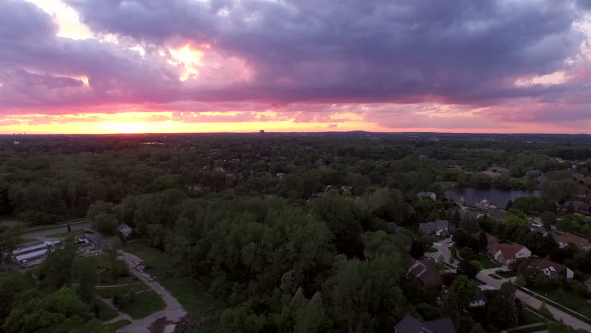 Troy Michigan Aerial v2 Flying low over neighborhood with sunset views. - HD stock footage clip