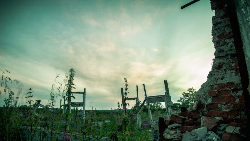 The wreckage of old buildings, overgrown grass - HD stock footage clip
