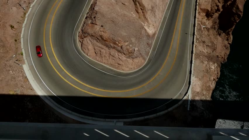 Traffic on a hairpin turn in a canyon - HD stock footage clip
