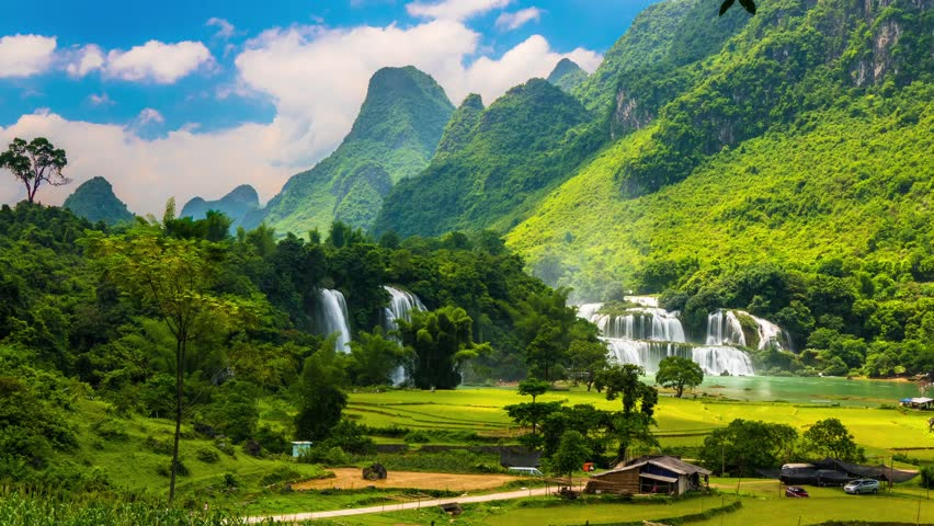 Ban Gioc Waterfall in green valley with rice fields, Vietnam, time-lapse #11596673