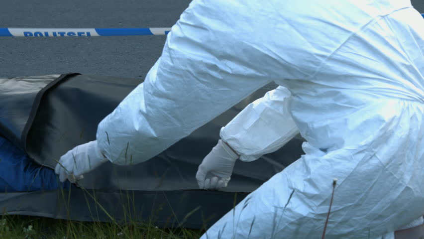 Coroner zip the body bag corpse inside | Shutterstock HD Video #11601812