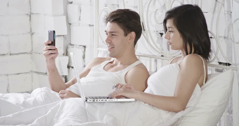 Young adult couple sleeping on the bed in bedroom | Shutterstock HD Video #11638856