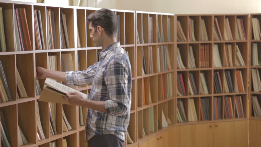 Student looking for a book in the library