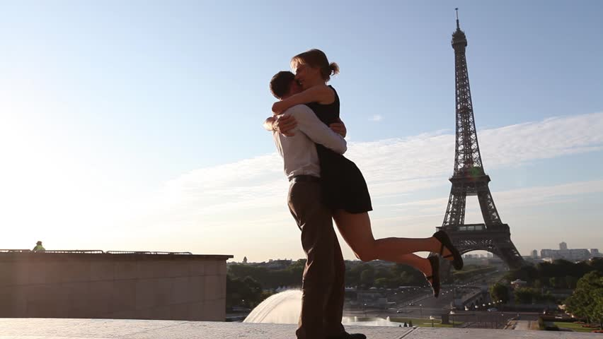 Happy young romantic couple having fun near Eiffel Tower in Paris, France | Shutterstock HD Video #11682146