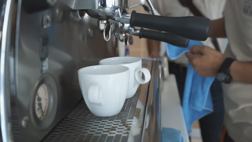 Coffee machine filling a cup with hot fresh coffee - HD stock footage clip