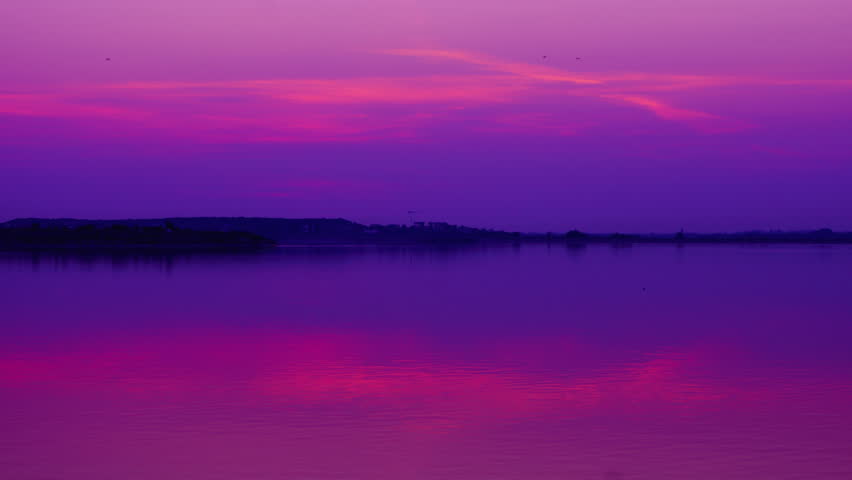 Pink sunset over lake,zoom in, time lapse - 4K stock video clip