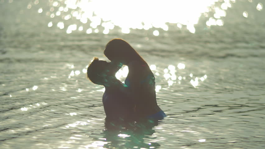 8 in 1 video! The couple (pair) walk on the beach and hug and kiss in the water with bright reflection surface. Real time and slow motion capture.  | Shutterstock HD Video #11725661