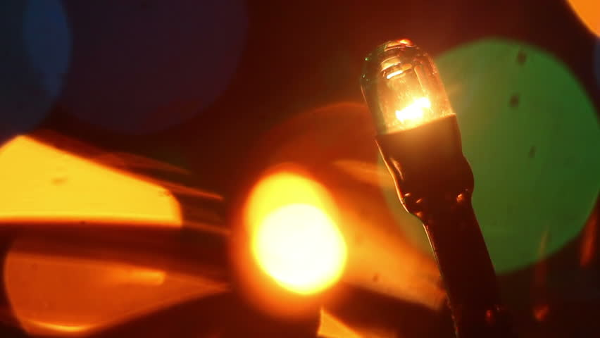 christmas lightbulb seamless loop extremly close-up  - HD stock video clip