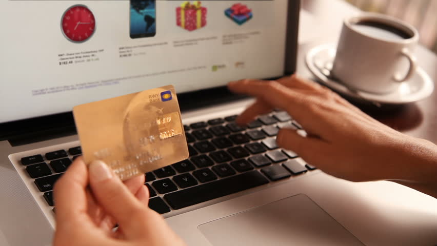 Online shopping. 3 shots. Dolly. Female hand holding a gold credit card and shopping online. More options in my portfolio.