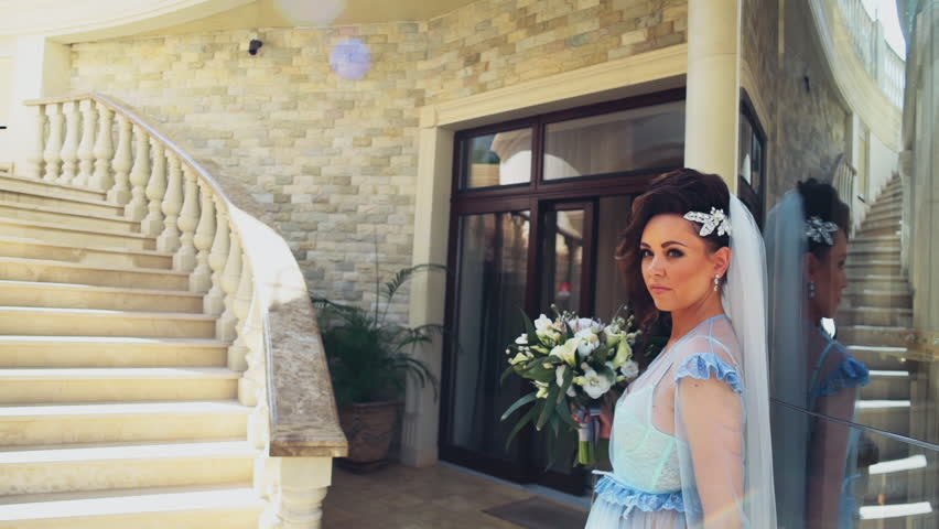 Beautiful bride poses in luxury exterior slow motion | Shutterstock HD Video #11745785