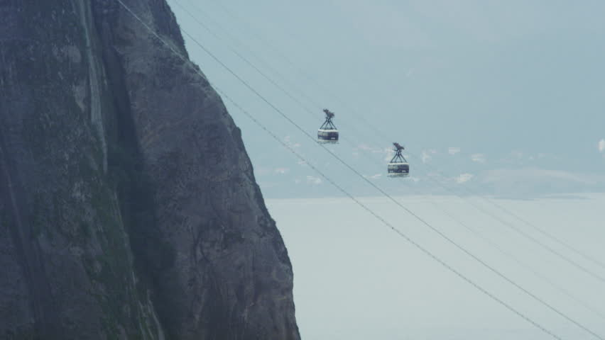 RIO DE JANEIRO - CIRCA JUNE 2013: Static shot of cable cars, one ascending while the other descends down Sugarloaf mountain in Rio De Janeiro at daytime | Shutterstock HD Video #11748035