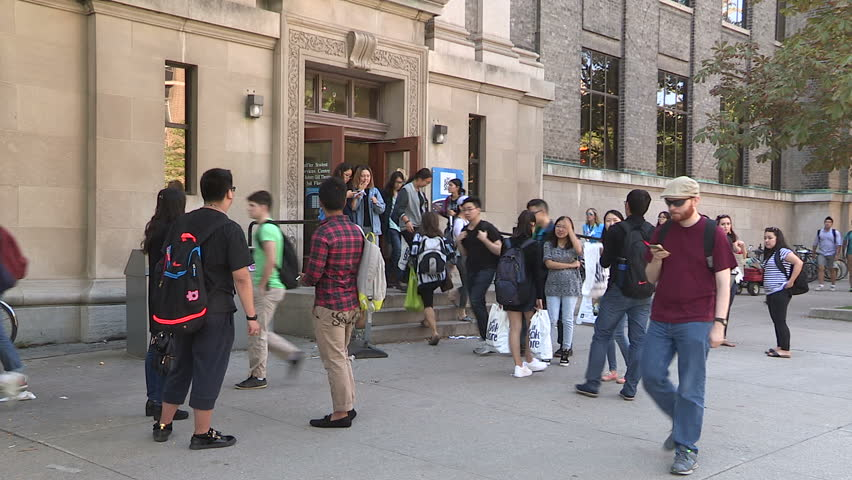 Toronto, Ontario, Canada September 2015 Diverse college and university students on campus on sunny summer day in Toronto - HD stock video clip