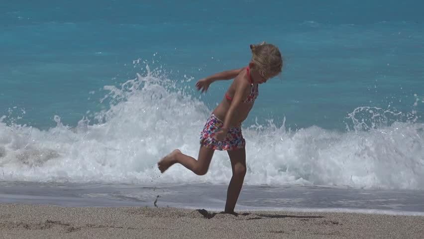 4K Child Playing on Beach Coastline in Waves Little Girl Running Walking Sea Kid - HD stock video clip