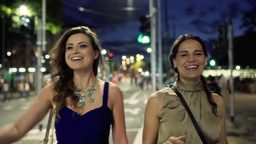 Friends meeting in the street at night, steadycam shot