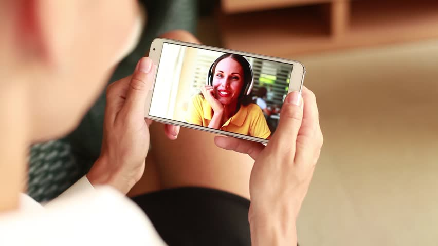 woman talking to a friend on video call on smart phone