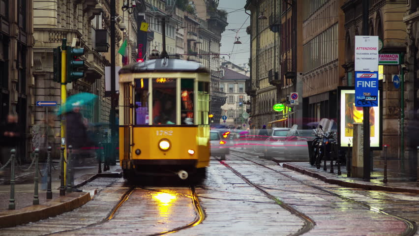 MILAN, ITALY - JULY 2015: night illumination city center famous streets square 4k time lapse circa july 2015 milan, italy.