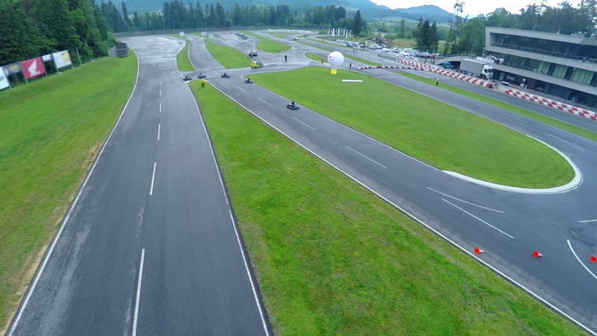 This is an air view on go cards driving on racecourse with asphalt courses on a countryside which is used for racing. | Shutterstock HD Video #11815202