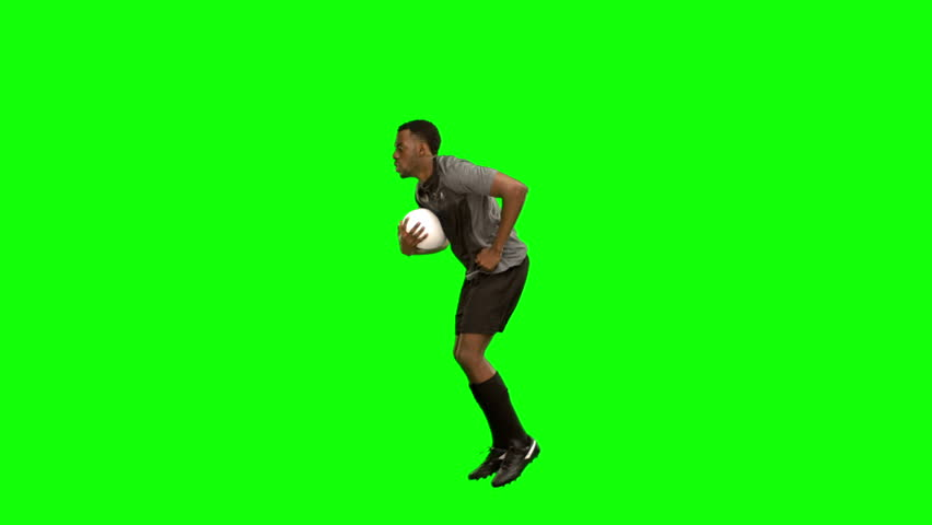 Serious rugby player running with ball on green screen background | Shutterstock HD Video #11831285