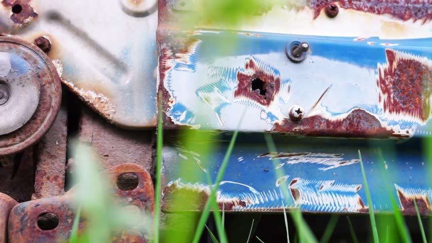 Old and rusty car details at scrapyard close up