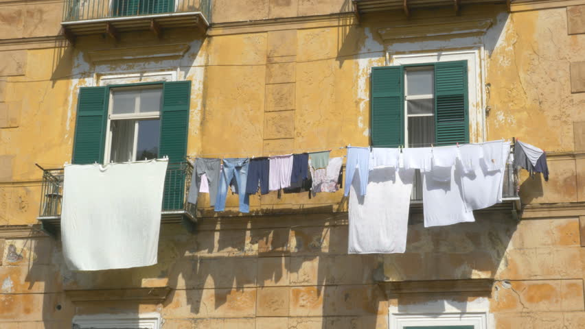 Laundry hung out to dry and blowing in the wind. Home in Amalfi, Amalfi Coast, Italy.