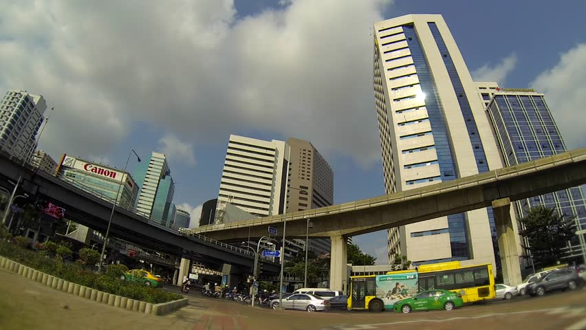 BANGKOK - March 2015: Bangkok's traffic with BTS sky trains passing by. Speed up.  Silom.  - HD stock footage clip