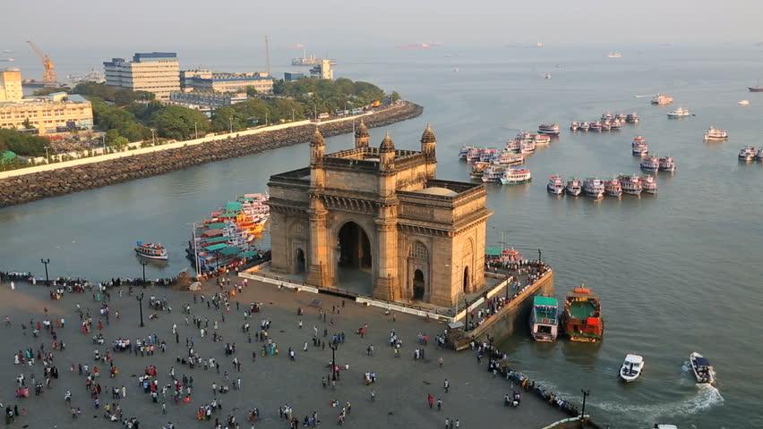 India - March 2015: Mumbai Gateway India Maharashtra Asia monument sunset vessel building sea city people palace travel tourist