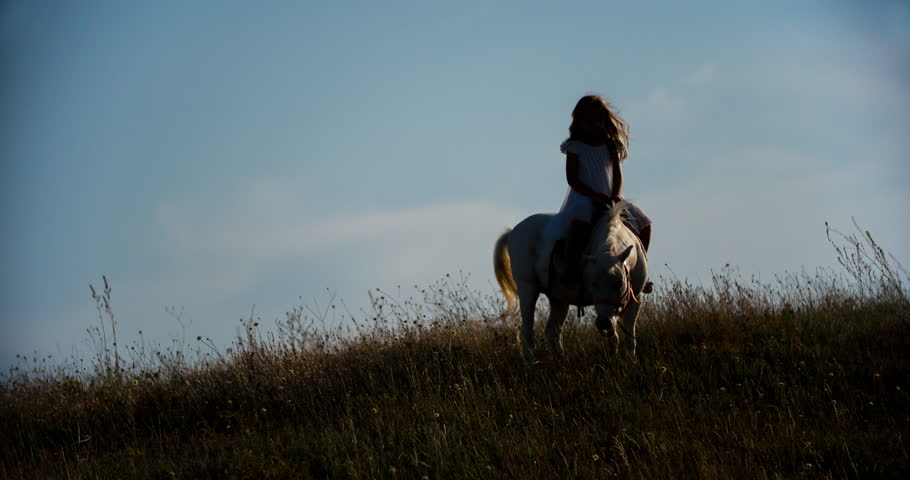BEAUTIFUL BLONDE GIRL RIDING A WHITE HORSE - 4K stock video clip