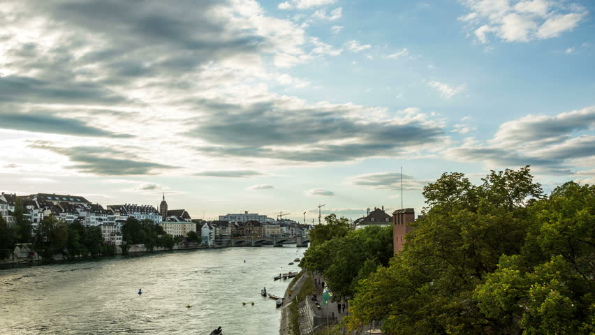 BASEL, SWITZERLAND – August 15, 2015: Basel city skyline and river  in the evening hyperlapse timelapse Skyline in the evening, with Rhein river and bridge  | Shutterstock HD Video #11930744