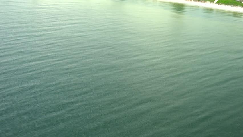 Fast Boat aerial cuts through frame. | Shutterstock HD Video #11944856