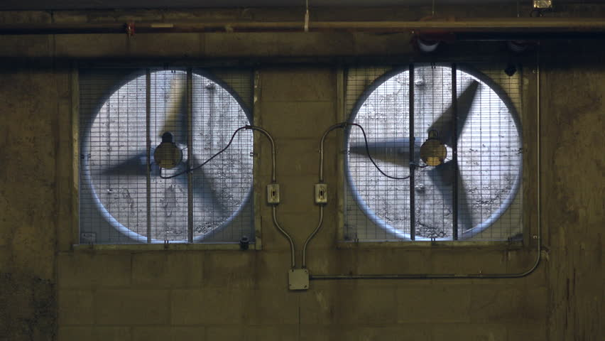 Industrial Sized Ventilator Fans In An Underground Building To Maintain Airflow, Could Be Used As A Background Design For A Post Apocalypse Background Or For A DJ Video Dancers Background.