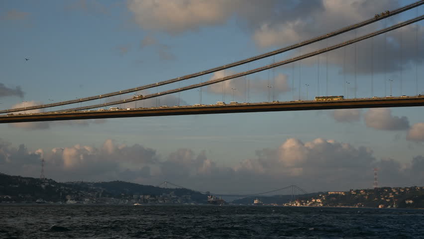 Istanbul, Turkey - September 17, 2015: Bosphorus Bridge and traffic timelapse with wonderful clouds at Istanbul, Turkey. Vehicles are visible at the bridge. Also boats are passing at The Bosphorus. - HD stock video clip