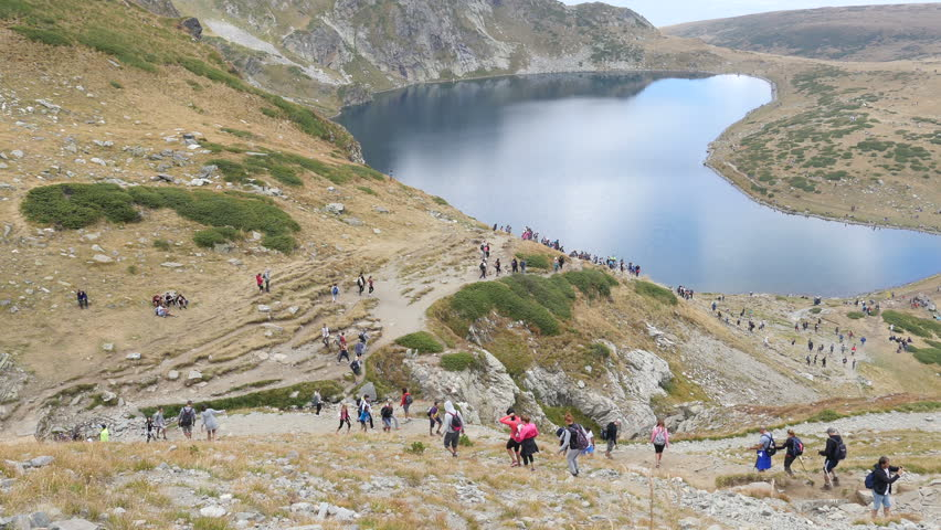 NATIONAL PARK RILA, BULGARIA - SEP 19, 2015 - People hiking in picturesque Bulgarian mountains in Rila Lakes Nature Park | Shutterstock HD Video #11993420