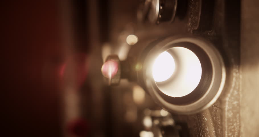 4K vintage film projector. Flashing lights to lens close up. Shot with RED EPIC in 4K DCI Native Resolution UHD.