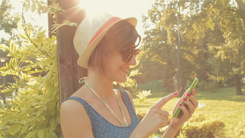 Girl using cellphone outdoors. - HD stock video clip