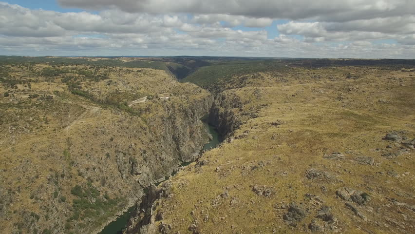 Deep in Arribes del Duero in Zamora, Spain. Sliding right to left to cliff over river in 4K, aerial view