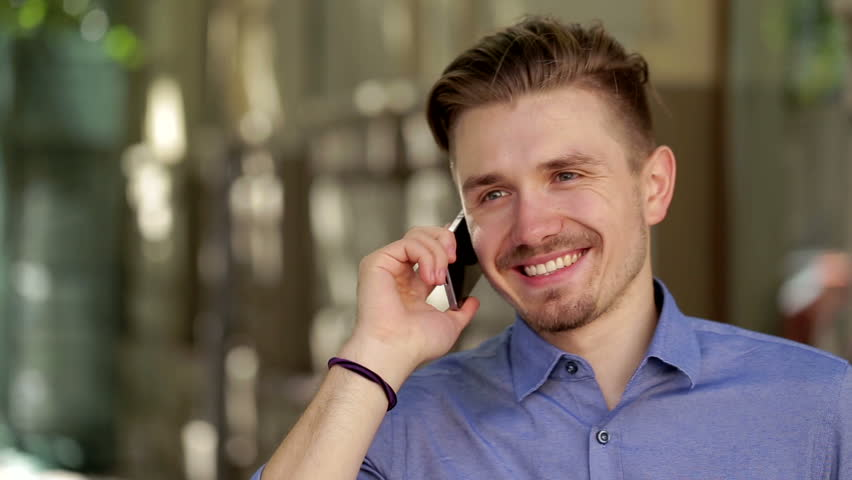Young businessman is talking on his mobile phone  outdoors | Shutterstock HD Video #12039725