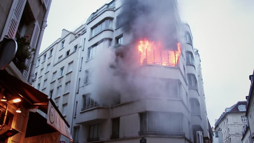 A building on fire and a lot of smoke in central Paris. 4 OCTOBER 2015 - PARIS, FRANCE; An apartment explodes and catches fire, breaking all the windows and killing one person.
