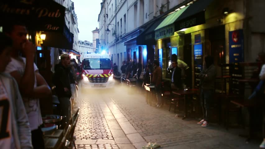 Emergency truck arrives in a fire scene in Paris. 4 OCTOBER 2015 - PARIS, FRANCE; An apartment explodes and catches fire, breaking all the windows and killing one person.
