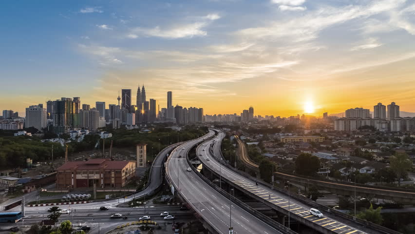Time lapse busy light trail traffic on a freeway of Kuala Lumpur, Malaysia during sunset - 4K stock footage clip