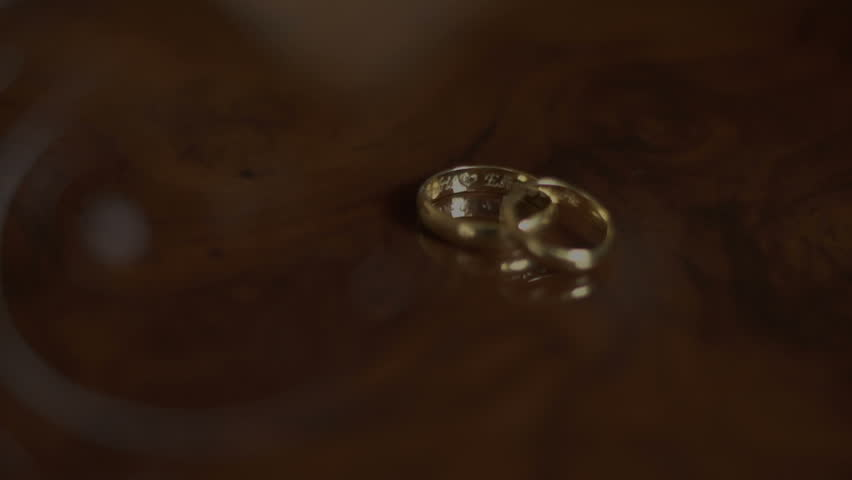 wedding rings on the table - HD stock footage clip