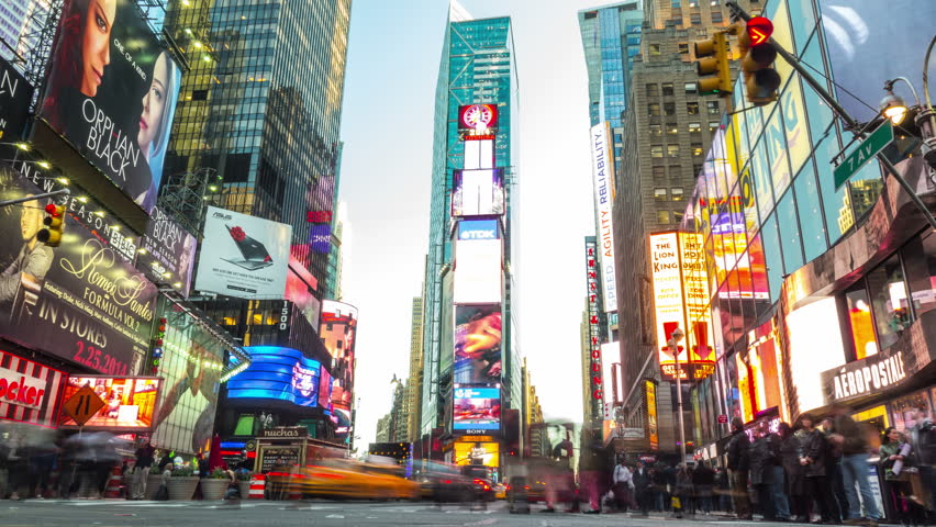 NEW YORK CITY - April 14, 2014: Time lapse of Times Square. Zoom in. Crowded street and traffic at the most famous commercial intersection and neighborhood in Midtown Manhattan. United States. #12213254