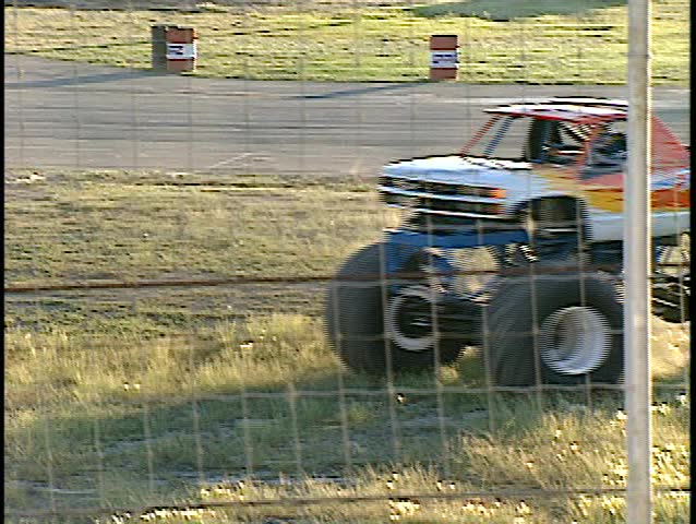 monster truck, doing dusty donuts (good audio) - SD stock footage clip