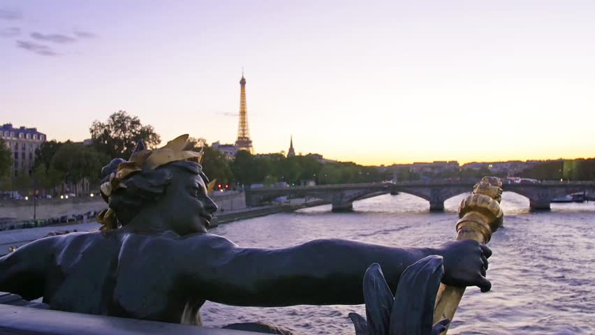 Paris, statue on Alexander III bridge on the river Seine with the Eiffel tower on the background - HD stock video clip