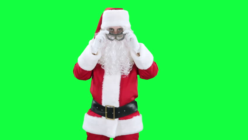 Santa Claus funny pilot chroma key (green screen). Santa Santa puts on his glasses and depicts a flying airplane isolated on green