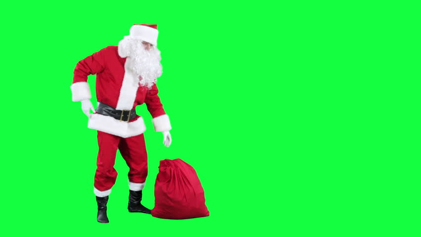 Santa Claus with a gift box chroma key (green screen). Santa pulls the present out of the bag  isolated on green