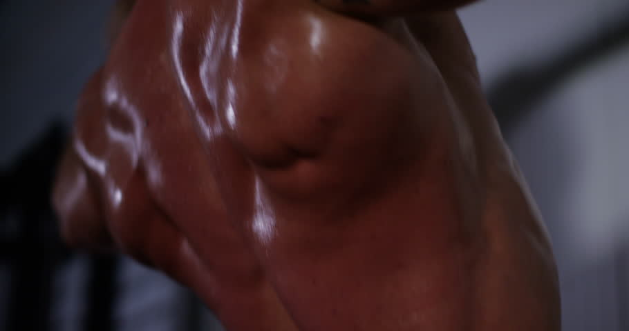 Close up of a body-builder chinning up on a bar. Shot on RED Epic. - 4K stock video clip